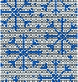 Knitted seamless winter pattern with snowflakes vector image