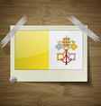Flags Vatican CityHoly See at frame on wooden vector image