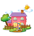 A little boy playing in front of their house vector image vector image