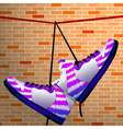 Hanging shoes vector image