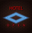 neon signboard hotel sign on a brick wall vector image