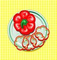 red sweet pepper on a plate with slices vector image