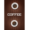 Two cups of coffee on wooden table vector image