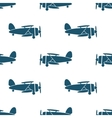 Seamless pattern with blue biplanes vector image