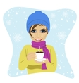 young woman having cup of hot chocolate in winter vector image
