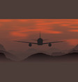 an airplane flying at sunset in mountains vector image