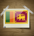 Flags Sri Lanka at frame on wooden texture vector image