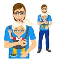 father holding little girl with baby carrier vector image