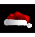 Santa Claus cap isolated over black background vector image vector image