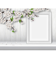 Spring blooming cherry branch and photo frame on a vector image