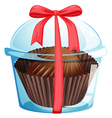 A cupcake inside a container with a red ribbon vector image vector image