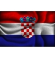 Crumpled flag of Croatia on a light background vector image