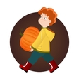 Red kid boy holding pumpkin on Halloween vector image
