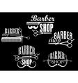 Vintage barber shop emblems on black background vector image