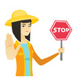 young asian farmer holding stop road sign vector image