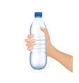 hand holding a water bottle vector image