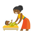 young african-american mother taking care of baby vector image