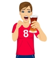 young man watching sports on tv vector image
