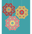 Three decorative circles hanging on strings vector image vector image