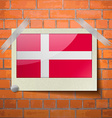 Flags Denmark scotch taped to a red brick wall vector image