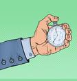 pop art male hand holding stopwatch vector image