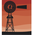 silhouette of a water pumping windmill vector image vector image