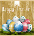 easter colored eggs on pine tree vector image