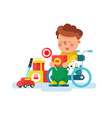 boy in a wheel chair with toys vector image