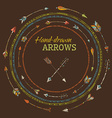 Round frames of ethnic arrows on brown background vector image