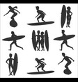 set of surfers silhouettes vector image