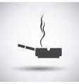 Cigarette in an ashtray icon vector image