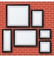 blank picture frame set on brick wall vector image vector image