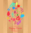 easter egg made from flowers on wooden background vector image