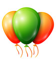 realistic green orange balloons with ribbons vector image