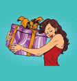 beautiful young woman hugging gift box vector image