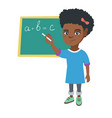 african schoolgirl writing on the blackboard vector image