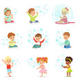 children playing with colorful soap bubbles vector image