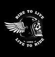 biker skull in helmet with wing on dark background vector image