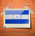 Flags Honduras scotch taped to a red brick wall vector image