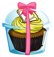 A cupcake with a yellow icing vector image