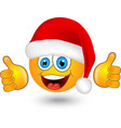 yellow round emotion in Santa hat vector image