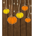 pumpkins on wooden background vector image
