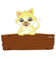 A yellow cat above the empty signboard vector image