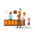 receptionist serves family gives keys to room vector image