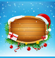blank wooden sign with santa red hat and winter vector image