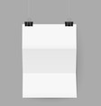 Sheet of paper folded in three hanging on paper cl vector image vector image