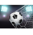 Soccer ball in the goal net on stadium with light vector image