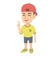caucasian little boy showing victory gesture vector image