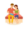 family is sitting on bed viewing photos album vector image
