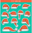Set of 12 red doodle hats sticker Santa Claus vector image